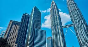The Petronas Towers in Kuala Lumpur, Malaysia; Image by badahos/AdobeStock