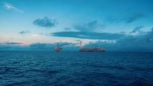 An FPSO next to an oil platform - Credit; Igor Kardasov/AdobeStock