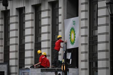 Activists blockade entrances to the BP headquarters in London, demanding an end to new oil and gas exploration. The campaigners arrived at 3 a.m. on Monday and encased themselves in heavy containers before the oil company's annual general meeting on