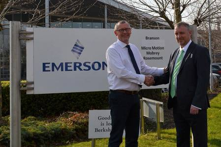 Ray Harrison, Managing Director of Delta Controls with Damian Selina, Managing Director of Emerson's Rosemount Measurement Ltd. sealing the deal which transfers Mobrey to Delta Controls. (Photo: Delta Controls)