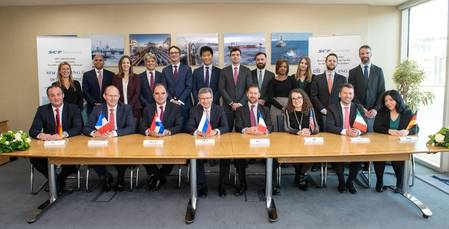 Nikolay Kolesnikov, Senior Executive Vice-President and CFO of Sovcomflot (sitting in the centre) together with the signees from KfW IPEX-Bank, Credit Agricole, ING Bank, Societe Generale, Citibank, UniCredit, and DVB Bank (sitting, from left to righ