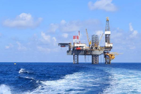 Illustration only; A jack-up rig next to an offshore platform  - Image by bomboman -AdobeStock